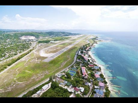 An aerial shot of the Sangster International Airport runway.