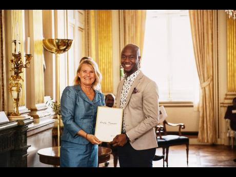 Head of Nation Branding at the Ministry of Foreign Affairs of Sweden, Gabriella Augustsson (left), presents the Global Swede Award to Sanjay Thompson on May 21 at Sweden's Ministry of Foreign Affairs.