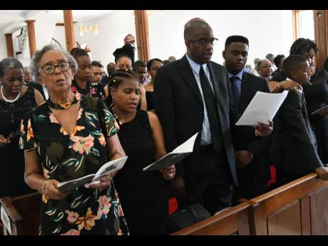 From left: Barbara Bailey, widow of the Reverend Cyril Evans Bailey, and other family members – Carolyn Bailey, Michael Bailey, Daryl Bailey, Stephen Bailey and Kerry-Ann Bailey – at the funeral for the former RJR chairman at the University Chapel yesterday.