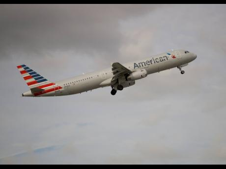 In this Thursday, November 29, 2018 photo, an American Airlines Airbus A321 takes off from Fort Lauderdale–Hollywood International Airport in Fort Lauderdale, Florida.