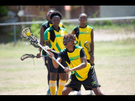 Alicia Thaxter (front) engages in training drills with her teammates at the Wolmer's Preparatory School playing field on Saturday, June 8. Jamaica's Under-19 Lacrosse team is preparing for the Federation of International Lacrosse Women's Under-19 Championships in Ontario, Canada from August 1-10.