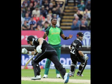 South Africa's bowler Lungi Ngidi (middle) reacts as New Zealand's captain Kane Williamson (right) takes runs during their ICC World Cup match at the Edgbaston Stadium in Birmingham, yesterday.