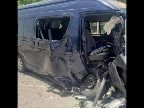 The Toyota Hiace minibus that was involved in yesterday's deadly crash in Hanover. The bus driver, Everton 'Wanga' Riley, and the driver of the car that crashed into it, Kevaughn Sutherland, both died.