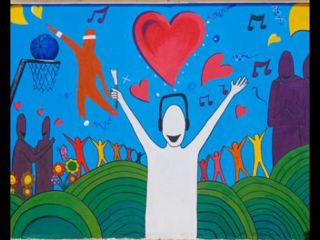 A completed mural designed and painted by patients of the Bellevue Hospital in Kingston. They were aided by students of the Edna Manley College of the Visual and Performing Arts.
