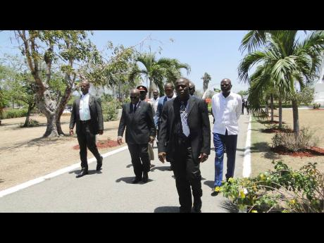 President of Ghana Addo Dankwa Akufo-Addo (second left) and his entourage making their way to the monument of National Hero Marcus Garvey at National Heroes Park on Sunday, June 16.