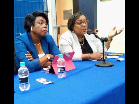 Retired Deputy and Acting Commisisoner of Police, Novelette Grant (Left) and chief executive officer of the Child Protection and Family Services Agency, Rosalee Gage-Grey (Right) participating in the Female Development World Organization's 2nd Biennial Protect  The Children Symposium at the University of Technology in St Andrew, on June 20, 2019.