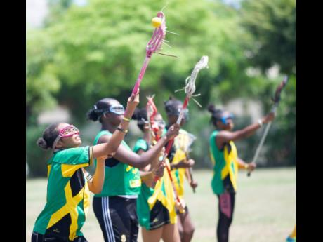 Jamaica's Under 19 women's lacrosse team in training at the Wolmer's Preparatory School playing field on Saturday, June 8.