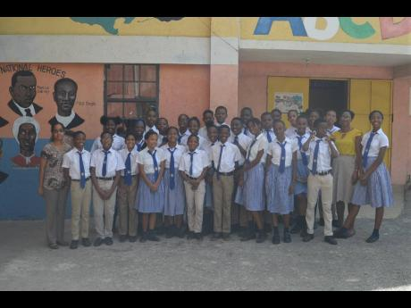 Members of the grade six cohort at Hosanna Preparatory School in Montego Bay, St James, with teachers Shammy Green-Dawkins (second right) and Chantelle Duhaney (left).