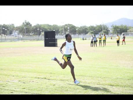 Denica Spence of Belmont Academy wins the Girls Class Two 200m race at the Council of Voluntary Social Services Summer Games at the UWI Mona Bowl on Saturday, July 7, 2018.