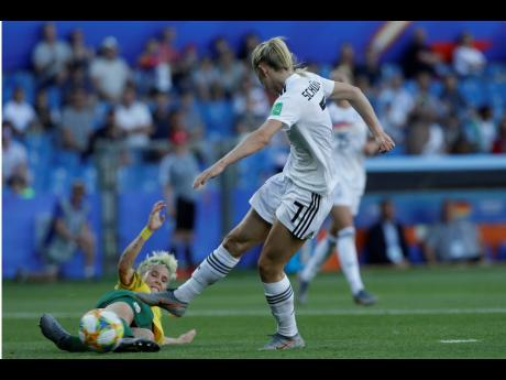 Germany's Lea Schueller (right) attempts a shot at goal as South Africa's Janine Van Wyk slides in for a block during their FIFA Women's World Cup Group B  match at the Stade de la Mosson in Montpellier, France on Monday. Germany is one of the teams contesting the Round of 16.