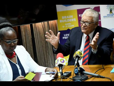 Karl Samuda, the minister overseeing the Ministry of Education, Youth and Information, and Permanent Secretary Dr Grace McLean speak to the media yesterday ahead of the release of the results for the inaugural sitting of the Primary Exit Profile tests this year. The press conference was held at the ministry's National Heroes Circle office in Kingston.