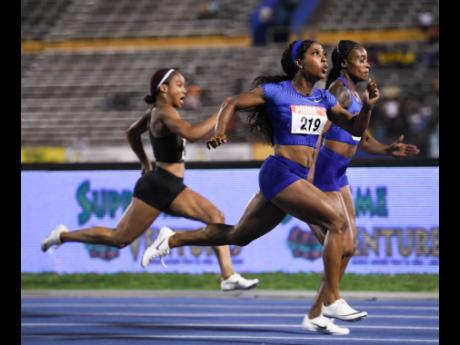 Elaine Thompson (back, right) edges Shelly-Ann Fraser-Pryce to take the Women's 100m final at the JAAA/Supreme Ventures National Senior Athletics Championships at the Natioanl Stadium. Thompson clocked a world-leading 10.73 seconds for victory, same time as Fraser-Pryce, while Briana Williams (left) finished an impressive third in 10.94 seconds to set a World Under-18 record in the event.