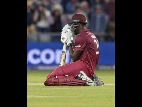 West Indies' Carlos Brathwaite reacts after losing the Cricket World Cup match against New Zealand at Old Trafford in Manchester, England, yesterday.