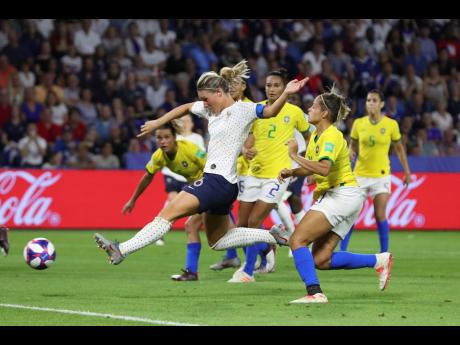 France's Amandine Henry (second left) scores her side's second goal during the FIFA Women's World Cup round-of-16 match against Brazil at the Oceane Stadium in Le Havre, France, yesterday.