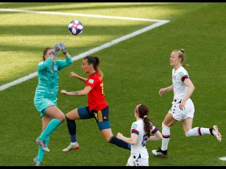 United States goalkeeper Alyssa Naeher (left) makes a save in front of Spain's Virginia Torrecilla (second left) during the FIFA Women's World Cup round-of-16 match between the sides at Stade Auguste-Delaune in Reims, France, yesterday.