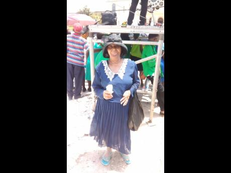 Seventy-year-old Elizabeth Edwards was determined not to miss 'Uncle Seaga's' funeral on Sunday, June 23, even though she had no invitation and was not allowed on the grounds of the Holy Trinity Cathedral on North Street in Kingston. She stood among huge crowds just across the street from the church, behind barriers.