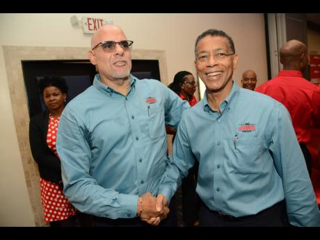 JMMB Group CEO Keith Duncan (left) and Chairman Archibald Campbell.