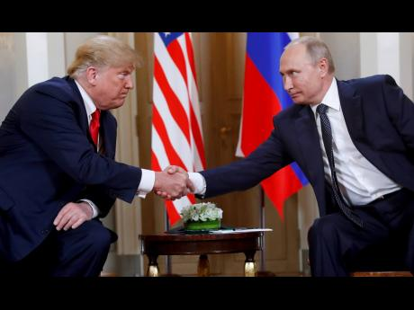 In this  July 16, 2018, file photo, US President Donald Trump (left), and Russian President Vladimir Putin shake hands at the beginning of a meeting at the Presidential Palace in Helsinki, Finland.
