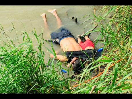 The bodies of Salvadoran migrant Oscar Alberto Martínez Ramírez and his nearly two-year-old daughter Valeria lie on the bank of the Rio Grande in Matamoros, Mexico, on Monday, after they drowned trying to cross the river to Brownsville, Texas. Martínez' wife, Tania, told Mexican authorities she watched her husband and child disappear in the strong current. This photograph was first published in the Mexican newspaper, La Jornada.