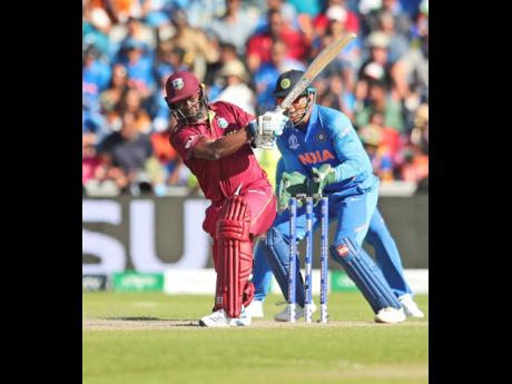 Windies' Kemar Roach plays a shot during the ICC World Cup match against India at Old Trafford in Manchester, England, yesterday.