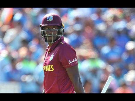 West Indies captain Jason Holder leaves the field after being dismissed by India's Yuzvendra Chahal during their Cricket World Cup match at Old Trafford in Manchester, England, on June 27.