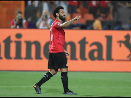 Egypt's Mohamed Salah reacts after he scored during the group A match between Egypt and DR Congo at the Africa Cup of Nations at Cairo International Stadium in Cairo on Wednesday.
