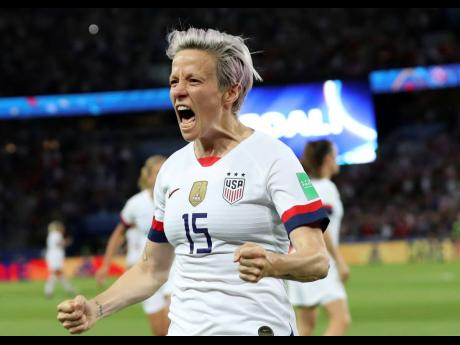 United States' Megan Rapinoe celebrates after scoring her side's second goal against hosts France during the FIFA Women's World Cup quarterfinal match at the Parc des Princes, in Paris, yesterday.
