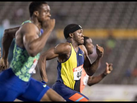 Orlando Bennett (right) sprints to the finish line after clearing the final obstacle in the 110m hurdles final at the Supreme Ventures Limited/JAAA National Senior Championships at the National Stadium on Sunday, June 23, 2019. Bennett placed second to Ronald Levy with a time of 13.27.