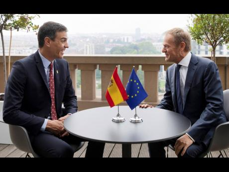 Spanish Prime Minister Pedro Sanchez (left), speaks with European Council President Donald Tusk during a meeting on the sidelines of an EU summit in Brussels yesterday.