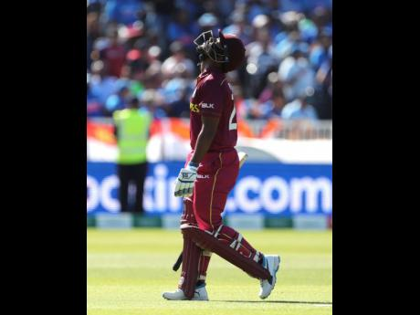 Windies batsman Nicholas Pooran looks to the sky in disappointment as he leaves the field after being dismissed by India's Kuldeep Yadav during their ICC World Cup match at Old Trafford in Manchester, England, on Thursday.