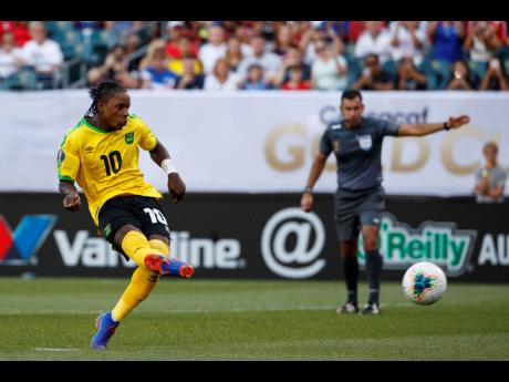 Jamaica's Darren Mattocks scores his penalty kick to give the Reggae Boyz a 1-0 win over Panama during the second half of their Concacaf Gold Cup match at the Lincoln Financial Field in Philadelphia, Pennsylvania, yesterday.