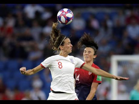 England's Jill Scott (left) heads the ball away from Norway's Ingrid Syrstad Engen during their FIFA Women's World Cup quarter-final match at Oceane Stadium in Le Havre, France on Thursday.