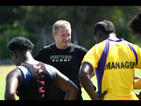 Newly appointed Jamaica Rugby Football Union coach, Stephen Lewis, shares instructions with the Jamaica Lady Crocs during a training session at Emmett Park in Kingston on Saturday morning. The Scotsman was appointed head coach of the senior men's team, and assistant coach of their female counterparts.