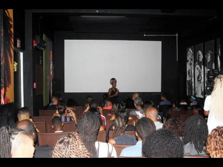 GATFFEST's deputy festival director Savannah Peridot gives a short welcome to the guests present for Jamaica Film Night 2, held at the Bob Marley Museum on the weekend.