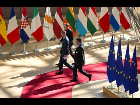 Czech Republic's Prime Minister Andrej Babis (centre) arrives for an EU summit in Brussels on Tuesday, July 2, 2019. EU leaders continued a third day of talks to seek a breakthrough in a diplomatic fight over who should be picked for a half a dozen jobs at top EU institutions.