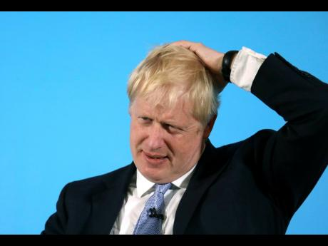 Conservative Party leadership contender Boris Johnson gestures as he speaks during a party leadership hustings in Belfast, Northern Ireland, on Tuesday, July 2, 2019.