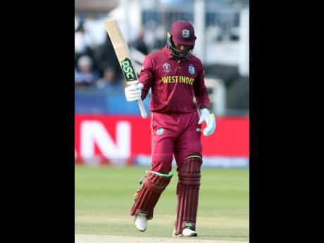 West Indies batsman Fabian Allen raises his bat after scoring a half -century during the Cricket World Cup match between Sri Lanka and the West Indies at the Riverside Ground in Chester-le-Street, England, on Monday, July 1, 2019.