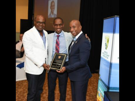 Altamont's CEO Chris Jarrett is flanked by Minister of Tourism Edmund Bartlett (left) and President of the Jamaica Hotel and Tourist Association Omar Robinson.