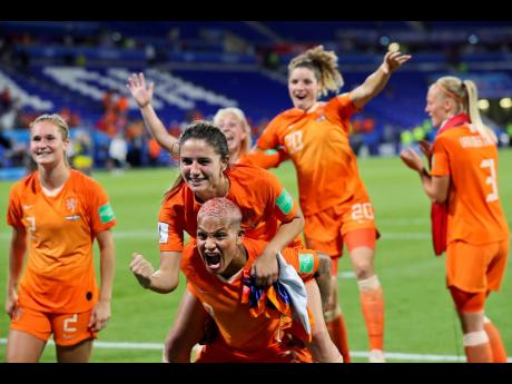Dutch players celebrate after winning the Women's World Cup semi-final match against Sweden at the Stade de Lyon outside Lyon, France, yesterday. The Netherlands defeated Sweden 1-0 after regulation and extra time.