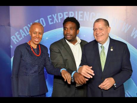 From left: Fayval Williams, minister of science, energy, and technology; Aldwyn Wayne CEO, WiPay; and Audley Shaw, minister of industry, commerce, agriculture and fisheries, show off their WiPay bands at the official launch of WiPay at the AC Marriott Hotel on Thursday, June 27.