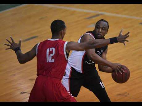 Andre McLean of UWI Running Rebels (left) stays close to Damion Campbell of Pure Playaz, who attempts a pass during the National Basketball League quarter-final game at the National Arena on Sunday, May 20, 2018.