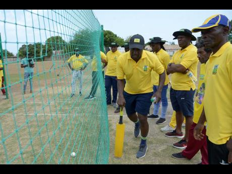 Wavell Hinds, former West Indies cricketer and president and CEO of the West Indies Players Association (WIPA),  goes through a demonstration exercise during a J. Wray and Nephew-sponsored WIPA coaching workshop at Kensington Cricket Oval on Wednesday, July 3.
