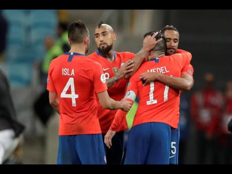 Chile's players react after loosing their Copa America semi-final match at the Arena do Grémio in Porto Alegre, Brazil, on Wednesday. Peru defeated Chile 3-0 and qualified for the final.