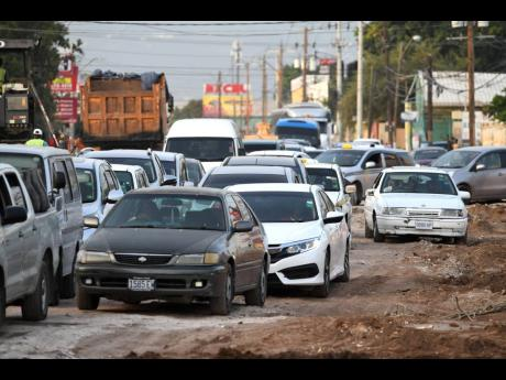 Motorists caught in a traffic jam Hagley Park Road due to road works  at the intersection with Waltham Park Road on Monday.