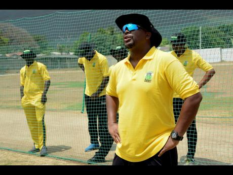 Robert Samuels, former Jamaica and West Indies cricketer, engages coaches from across the island during a West Indies Players' Association/Wray & Nephew training session at the Kensington Cricket Oval on Wednesday, July 3, 2019.