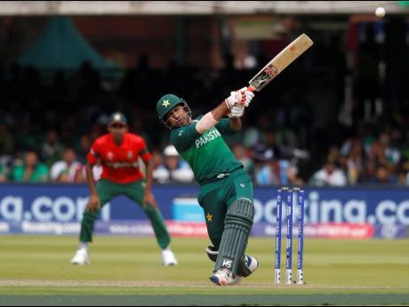 Pakistan's captain Sarfaraz Ahmed hits 4 runs off the bowling of Bangladesh's Mohammad Saifuddin during the Cricket World Cup match between Pakistan and Bangladesh at Lord's cricket ground in London, yesterday.
