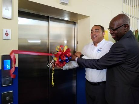 Minister of Health and Wellness Dr Christopher Tufton and Member of Parliament for Eastern St Thomas Dr Fenton Ferguson cut the ribbon at the commissioning of the elevator in the newly renovated and opened A&E Dept at Princess Margaret Hospital in St Thomas.