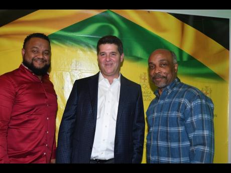 Christopher Samuda (right), president of the Jamaica Olympic Association (JOA), and Ryan Foster (left), CEO and general secretary, JOA, stand alongside Wisynco Group chairman William Mahfood, following his Olympic Week lecture at Olympic Manor, the JOA headquarters in Kingston, on Wednesday evening.