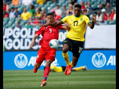 Panama's Gabriel Torres (left) and Jamaica's Damion Lowe battle for the ball during the first half of a CONCACAF Gold Cup match, Sunday, June 30, 2019, in Philadelphia. Jamaica won 1-0.