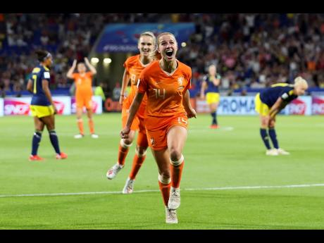 Netherlands' Jackie Groenen celebrates after scoring during the Women's World Cup semi-final match between the Netherlands and Sweden, at the Stade de Lyon outside Lyon, France, Wednesday, July 3, 2019.